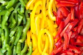 Sliced Colourful Paprika Peppers Background