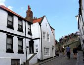 WHITBY, NORTH YORKSHIRE, ENGLAND - 20th May 2014: Whitby resort on the 20th May 2014. This is a popular tourist destination every summer, particularly from visitors from European countries.