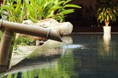 picture of peace-pipe  - picture of water falling down from bamboo pipe - JPG