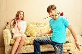 stock photo of sweethearts  - Young man giving flowers to his sweetheart - JPG