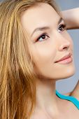 Pretty girl teenager with long hair and beautiful smile expressing happiness. Hair care, healthy hair.