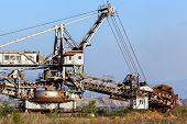 A Giant Bucket Wheel Excavator At Work In A Lignite Pit Mine With A Dirt Road Leading To It In The F