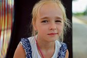 image of sitting a bench  - Closeup portrait of adorable little girl sitting on the bench - JPG