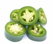 pic of jalapeno peppers  - sliced green jalapeno peppers on white background - JPG