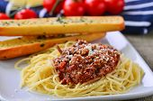 stock photo of baguette  - Spaghetti Bolognese With Garlic Bread Baguettes and on the vine tomatoes - JPG