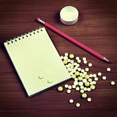 foto of prescription pad  - Toned Photo of Writing Pad and the Pills on the Wooden Table - JPG