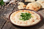 stock photo of chickpea  - Hummus traditional Jewish creamy lunch salad with chickpeas - JPG