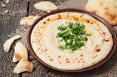picture of chickpea  - Delicious traditional hummus Hebrew lunch with chickpea beans - JPG