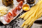 picture of carbonara  - Ingredients for pasta carbonara on a rustic background - JPG