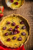 stock photo of tarts  - Lemon tart with rosemary and berries filled with cream topped berries - JPG