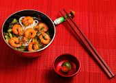 image of rice noodles  - Vietnamese shrimp and rice noodles soup pho served on a bamboo place mat - JPG