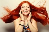 image of flowing hair  - Beautiful young happy woman with long flowing red hair - JPG