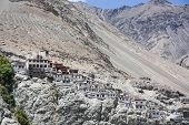 stock photo of buddhist  - Diskit monastery is the largest and the oldest Buddhist monastery in the Nubra Valley of Ladakh and was founded in 1433 - JPG