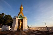 stock photo of peeing  - Standing gold Buddha image name is Wat Sra Song Pee Nong in Phitsanulok - JPG