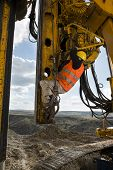 image of foundation  - Construction worker climbing on drilling pile foundation - JPG