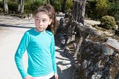 stock photo of ten years old  - Young and pretty girl ten years old playing at the park - JPG