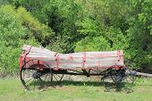 picture of wagon  - Historic wooden wagon with logs on it taken in the rural Oklahoma countryside - JPG