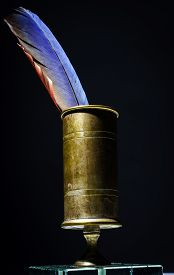 foto of inkpot  - Vintage inkpot with goose-quill inside retro writing instrument