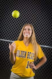 image of softball  - Young Female Softball Player Portrait with Ball in the Air - JPG