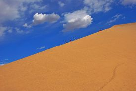stock photo of oasis  - Crescent Spring  Dunhuang oasis Desert mountain Gansu China - JPG