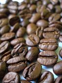 picture of colombian currency  - close shot of some roasted coffee beans - JPG