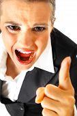 Furious modern business woman shaking her finger