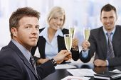 Businessman Celebrating With Champagne