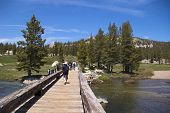 Hikers on Tuolumne bridge, Yosemite