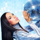 Beautiful brunette with a disco ball