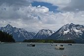 stock photo of u-boat  - fishing boats on lake with the backdrop of the grand tetons in wyoming u - JPG