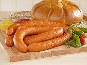 pic of grilled sausage  - Fresh sausage on a cutting board with bread - JPG