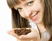 Smiling girl holding coffee grain