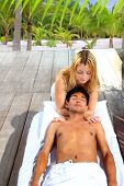 massage therapy stretch head neck outdoor palm trees tropical beach