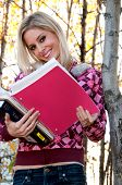 Woman Holding Schoolbooks