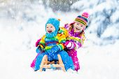 Kids On Sleigh Ride. Children Sledding. Winter Snow Fun. poster