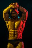Healthy Muscular Young Man After Workout On Dark Background. Naked Athlete With Strong Body. Bodybui poster
