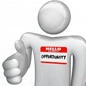 A person holds out his hand for a handshake, greeting you with a nametag reading Hello My Name is Opportunity, representing a new opportunities for your career, job, business or life prospects