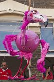 A Giant Flamingo Puppet Hanging From An Apartment Window At The Notting Hill Carnival