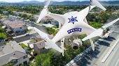 Police Unmanned Aircraft System, (UAS) Drone Flying Above A Neighborhood and Street. poster