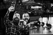 Online Communication. Man Bearded Hipster Hold Smartphone. Taking Selfie Concept. Take Selfie Photo  poster