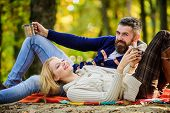 Romantic Picnic Forest. Couple In Love Tourists Relaxing On Picnic Blanket. Vacation Weekend Picnic  poster