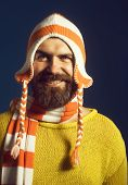 Autumn-winter Fashion. Handsome Bearded Man In Fashionable Warm Sweater, Hat, Scarf. Male Fashion. A poster