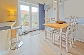 stock photo of rebuilt  - colour image kitchen in newly restored rebuilt house work surfaces - JPG