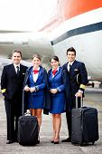 Pilots and air hostesses ready to fly in an airplane
