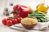 Ingredients for bulgur pilaf on a table