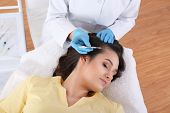 Young Woman With Hair Loss Problem Receiving Injection In Salon, Top View poster