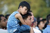 NEW YORK - JUNE 25:  A child sits on his father's shoulders as they attend the Greater New York Bill