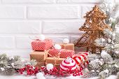Decorative Fur Tree, Wrapped Christmas Presents, Fur Tree Branches, Balls And  Red Berries On White  poster