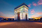 Arc De Triomphe De Paris At Night In Paris, France. poster