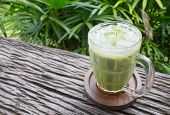 Cold Green Tea Milk Beverage Or Cold Drinks Right Frame Crosswise View. Green Cold Drinks And Ice On poster